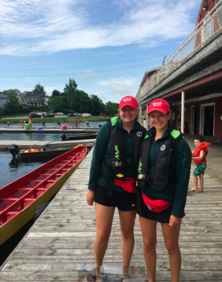 Volunteer instructors Lucy and Carys at the docks