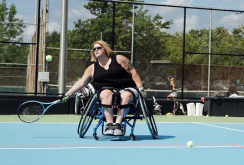 wheelchair tennis player hitting the tennis ball