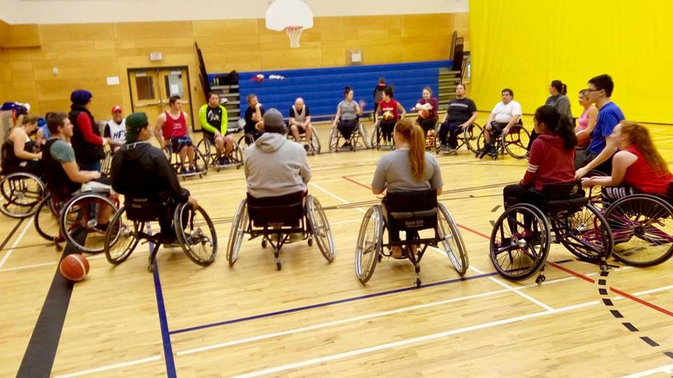 20 wheelchair basketball players in practice